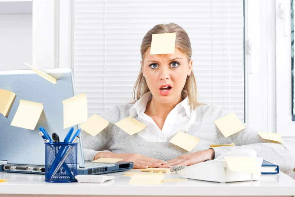 Woman with post-it notes all over her